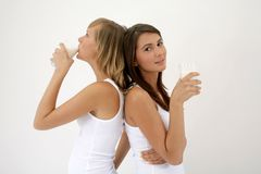 Two girls drinking milk Stock Images
