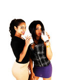 Two girls drinking Milk. Royalty Free Stock Images