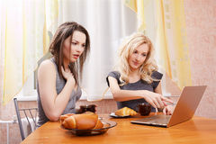 Two girls drinking tea Stock Image