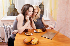 Two girls drinking tea Royalty Free Stock Images