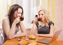 Two girls drinking tea Stock Photo