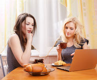 Two girls drinking tea Royalty Free Stock Photography