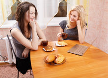 Two girls drinking tea Stock Photos