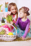 Two girls with Easter baskets royalty free stock images
