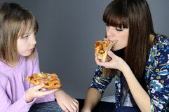 Two girls eating Stock Image