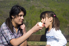 Two girls eating an apple Royalty Free Stock Images