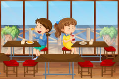 Two girls eating in the canteen stock illustration