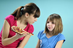 Two girls eating fast-food Royalty Free Stock Photos