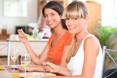 Two girls eating Stock Photography