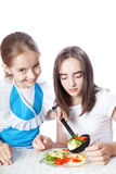 Two girls eating vegetarian salad Royalty Free Stock Photography