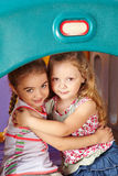 Two girls embracing in kindergarten Royalty Free Stock Photo