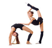 Two girls engaged art gymnastic Stock Images