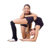 Two girls engaged art gymnastic Stock Photos