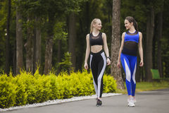 Two girls are engaged in sports walking Stock Images