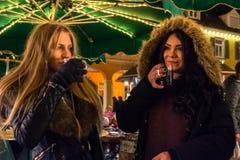 Two Girls Enjoying Mulled Wine German Christmas Market European royalty free stock photos