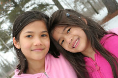 Two girls enjoying the winter Royalty Free Stock Image