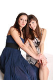 Two girls in evening dresses Royalty Free Stock Images