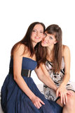 Two girls in evening dresses Stock Photos