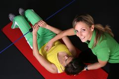 Two girls exercising Stock Photo