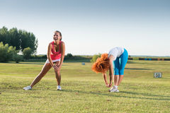 Two girls exercising Royalty Free Stock Photography