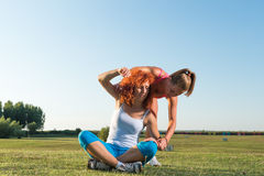 Two girls exercising Stock Photos