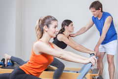 Two girls exercising in pilates Royalty Free Stock Image
