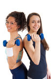 Two girls exercising with weights Stock Images
