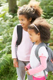Two Girls Exploring Woods Together Royalty Free Stock Photo