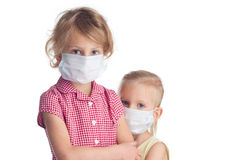 Two girls in fase mask Royalty Free Stock Image
