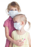 Two girls in fase mask Royalty Free Stock Images