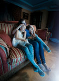 Two girls fell asleep with mother while watching TV Stock Photos