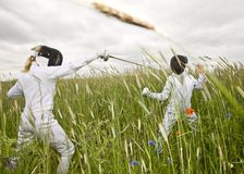 Two girls fencing Stock Photography