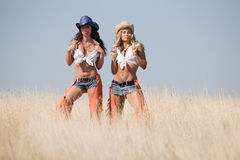 Two girls at the field Royalty Free Stock Images