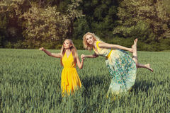 Two girls in the field. Stock Photo