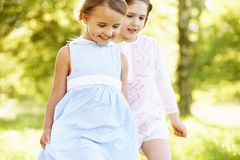 Two Girls In Field Together On A Walk Royalty Free Stock Images