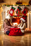 Two girls fighting for box with Christmas present Stock Photography