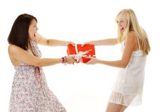 Two Girls fighting over a gift Stock Photos