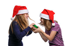 Two girls fighting over a present Royalty Free Stock Images