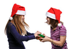 Two girls fighting over a present Stock Photography