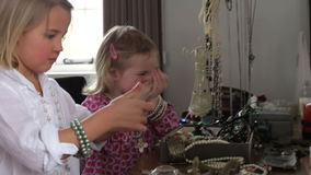 Two Girls Filing Nails And Playing With Jewelry In Bedroom stock footage
