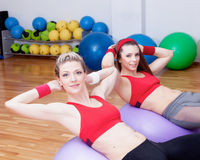 Two girls in fitnes club Royalty Free Stock Image