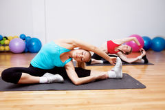 Two girls in fitnes club Stock Photo