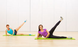Two girls at fitness club Royalty Free Stock Photography