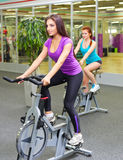 Two girls at fitness club Royalty Free Stock Images