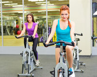 Two girls at fitness club Royalty Free Stock Image
