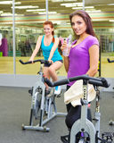 Two girls at fitness club Stock Images