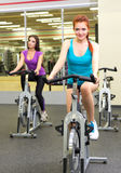 Two girls at fitness club Stock Photo
