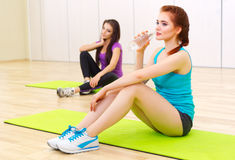 Two girls at fitness club Stock Photography