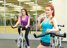 Two girls at fitness club Stock Image