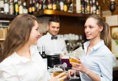 Two girls flirting with barman Royalty Free Stock Photo